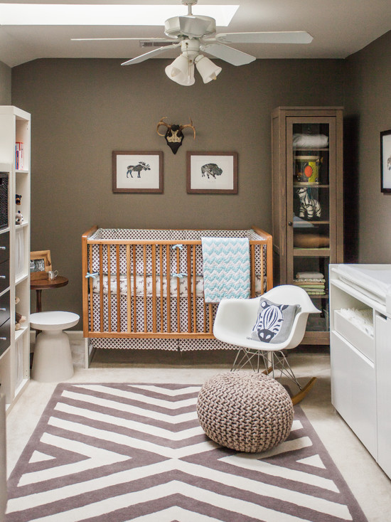 Outstanding-Modern-Nursery-Ideas-For-Boys-Using-Glass-Shelves-And-Ceiling-Fan-Over-the-White-Armchair-And-Wooden-Crib-Combined-with-Unique-Pattern-Rug